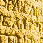 Greek writing inscribed in stone wall